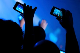 168723557-concert-video-recording-with-cell-phone.jpg